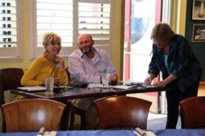 Secretary, Christine Becker, and Membership Chair, Kurt Bassett, check-in meeting attendees.